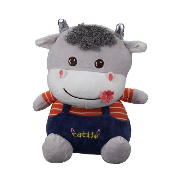 عروسک گاو گل بر دهان پسر
